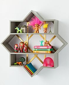 Shop Genevieve Gorder Star Wall Shelf. This wall shelf's brushed gold accents and star-shaped silhouette will bring a burst of style to any kids room, playroom or shared space. Plus, its sturdy wood frame allows it to hold plenty of decor, toys and more.
