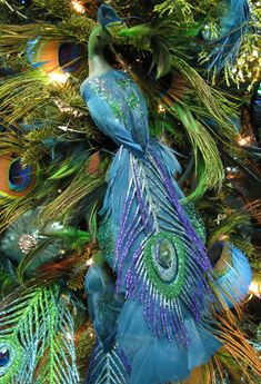 More peacock decorations have arrived! Sequined peacocks, glittered birds with long feather tails, garlands, wreathes, and hanging fea...