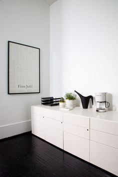 :: INTERIORS :: love how simple and organized things look when black and white - black plywood floors, white walls