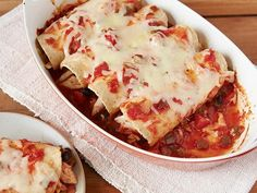 Chicken Enchiladas: These super-convenient enchiladas are all about layering. Start by pouring your favorite jarred salsa in the bottom of your baking dish. Line up your rolled tortillas before piling on more salsa and cheese.
