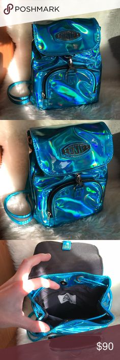 UNIF holo Quip mini Backpack Really good condition! Maybe worn 3 times, it doesn't fit my style anymore and I'd like to see him go to a new home. Bags Backpacks