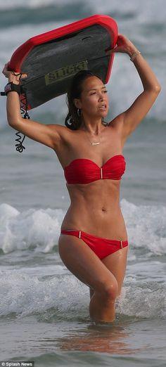 Myleene Klass flaunts her enviably toned figure in skimpy red bikini