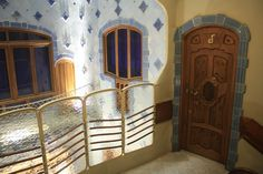 Spacious landing with direct views towards the blue tiling of the building well.The windows in Casa Batlló, like the one of this picture, play a double role: the upper part being for illumination and the lower part for ventilation