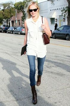 1ed115354aba keep it classic in skinny jeans and a sleeveless white button-down paired  with equestrian