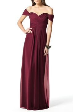 Softly draped cap sleeves barely touch the shoulders as they frame the wide square neckline of this airy chiffon gown in burgundy.