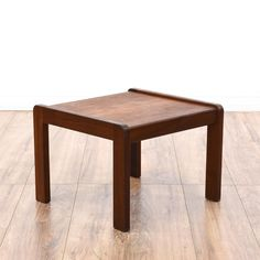 This mid century modern end table is featured in a solid wood with a glossy dark cherry finish. This small end table has simple straight legs, curved edges and a low table top. Sleek piece perfect for a low sofa! #midcenturymodern #tables #endtable #sandiegovintage #vintagefurniture