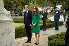 Prince William, Duke of Cambridge (L) and Catherine, Duchess of Cambridge (R) place a flower on the War Memorial at the Cambridge Town Hall on April 12, 2014
