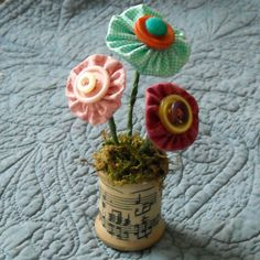 Button flowers in a wooden spool by All things Homey