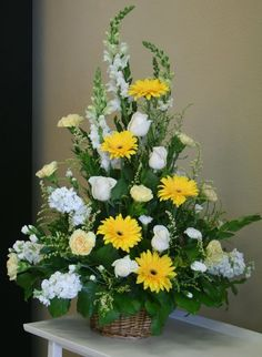 Yellow and white funeral flowers by you local Riverside florist - Willow Branch Florist of Riverside http://www.floristofriverside.com/