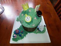 Alice in Wonderland giant cupcake Giant Cupcakes, Alice In Wonderland, Desserts, Food, Girls, Tailgate Desserts, Meal, Dessert, Eten