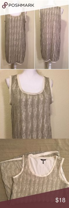 """Daisy Fuentes Silver & Gold Destroyed Tank Dress Size L.  Excellent like-new condition – no pulls or defects.  Cream raw-edge trim.  Length top of shoulder to hem: 34.5"""".  Bust: 40"""".  Waist: 40"""".  Bottom of dress: 42"""" around.  Poly/rayon/nylon blend.  Hand wash.      Love it but not the price - I'm open to (reasonable) offers or consider bundling 2 or more items for an additional 15% off and combined shipping!     Check out my reviews - I only sell great quality items! Daisy Fuentes Dresses…"""