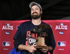 (Nathan Denette/The Canadian Press via AP). Cleveland Indians relief pitcher Andrew Miller accepts the MVP trophy for the series after the Indians defeated the Toronto Blue Jays 3-0 in Game 5 of the baseball American League Championship Series in Toronto.