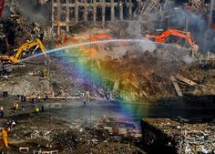 Water sprayed by a firefighter creates a rainbow at the site of the World Trade Center terrorist attack, October 2001.