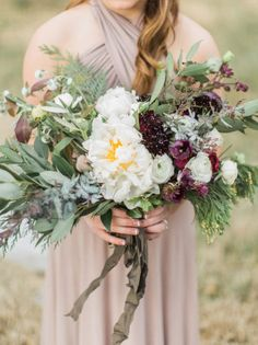 Large bouquets for the bridesmaids are such a good idea, and we love the plum colored flowers in this one! Captured by Tracy Enoch Photography #bridesofnorthtx #wedding #bouquet