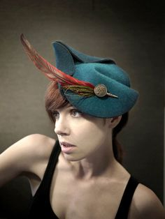 Teal Felt Fascinator With Red and Green Feathers  by pookaqueen, $126.00  Nice hat