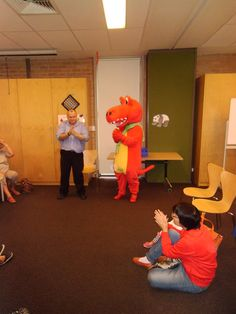 Redsee the Readasauraus entertains children at Constitution Hill Library.