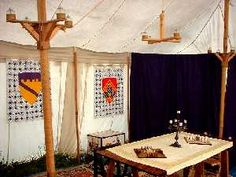 (Heraldry on inside Tent Wall of Social Tent) Pole Chandeliers and gaming space