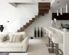 This straight staircase with glass balustrade was designed by Elite Metalcraft. Combination of American walnut treads and risers, to both top, bottom and sides of the stair, with a structural glass balustrade. Stairs In Living Room, House Stairs, Steel Stairs, Wood Stairs, Cantilever Stairs, Space Saving Kitchen, Room Kitchen, Kitchen Cabinets, Glass Stairs