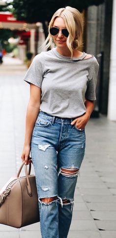 #fall #outfits  women's grey scoop-neck shirt and distressed blue-washed jeans