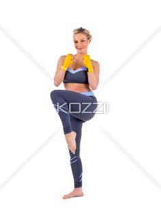 woman kick boxer - Woman kick boxer in a landscape image
