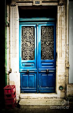 Ornate Doors, France. This blue door is amazingly cool...