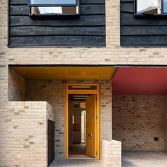 The architecture studio replaced a 1970s double garage with a home that matches the adjoining properties in scale and materials as the latest stage of the development of a service lane into a residential street. Brick Courtyard, Recycled Brick, British Architecture, Monochrome Interior, Mews House, Charred Wood, Two Storey House, Small Courtyards, Ground Floor Plan