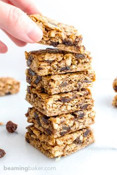 Oatmeal Raisin Cookie Bars (V+GF): an easy recipe for soft, chewy cookie bars made from simple ingredients, bursting with juicy raisins. Vegan, Gluten Free.