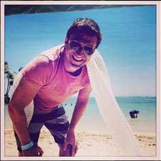 Raul Esparza on the beach in Hawaii smiling cute