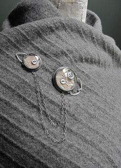 Brooch with vintage watch crystals, buttons, and linen.  By Quench Metalworks...