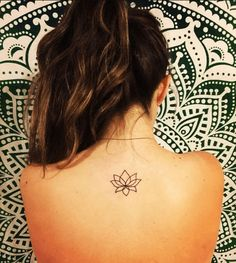 Simple Small Lotus Flower tattoo Idea on Back