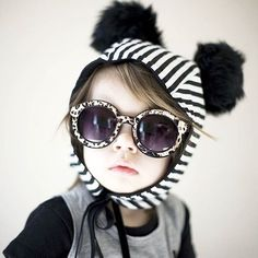 There are still some stripe pom bonnets on the website. @hmstrata's little is totally rocking it here! #toddlerfashion #monochrome #lunaflectaw15