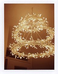 String balloon balls with mini lights inside string chandeliers idea for a christmas light chandelier aloadofball Choice Image
