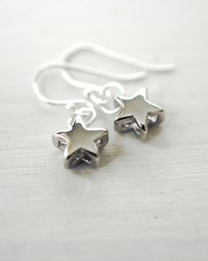Hey, I found this really awesome Etsy listing at https://www.etsy.com/listing/126596436/345-silver-twinkle-little-star-earrings