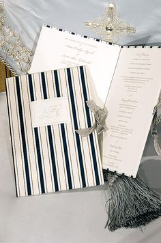 (Navy blue and white striped wedding programs are tied with a gray ribbon)  Formal Black Tie Wedding, Nautical || Colin Cowie Weddings