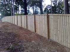 Pine Paling Fence Lapped Capped and Exposed Hardwood Posts with Sleeper Base