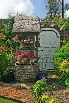 thatched wishing well for garden...