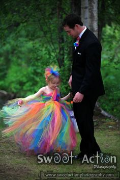 Alaska Wedding Photographers Tie Dye fRENZY!  This is what Lance & Ariel's wedding was about.   A nice small gathering of friends & family in the woods of the grooms' parents  house in Wasilla, Alaska.  The wedding included awesome tie dye flowers, her friends in tie dye dresses, and the flower girl in a fairy…