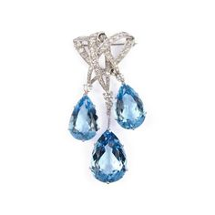 - Aquamarine and diamond triple drop scroll brooch by Cartier, London 1963,