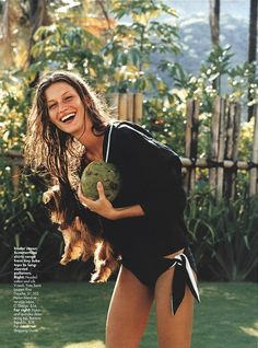 Gisele Bündchen smiling with a puppy and a coconut, photographer by Gilles Bensimon for Elle magazine. May 2000.