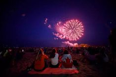 People watch fireworks fly over Ashbridges Bay during Canada Day festivities, on July 2019 in Toronto, Canada. Canada Day commemorates the July 1867 formation of Canada from three distinct colonies. Canada Day, Toronto Canada, John Tory, Centennial Park, Patriotic Outfit, Woman Smile, Fireworks, Ontario, Coast