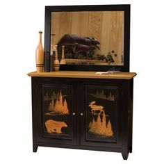 """2-door cabinet with a wilderness-inspired design.  Product: CabinetConstruction Material: WoodColor: Black and naturalFeatures: Two doorsDimensions: 36"""" H x 46"""" W x 14"""" DNote: Mirror not included"""