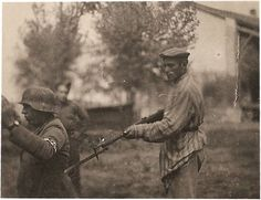 Powerful photo of a newly liberated Holocaust victim holding his former captor at gunpoint, 1945 - Imgur