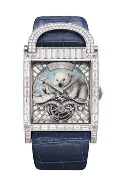 The DeLaneau Dôme Tourbillon Polar Bear watch in white gold features a Grand Feu miniature enamelled dial and a tourbillon movement, set with baguette-cut diamonds and diamonds