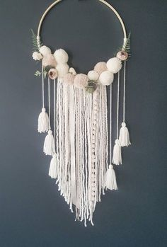Wall Hanging - Custom To Order Make your wall beautiful with this soft and boho dreamcatcher! Perfect for any room! The base is a natural wood hoop made of artificial flowers and pom poms. The extensions are a variety of cream ribbon, off white wool and lace. Size guide: #wallhangings #decorativeplaques