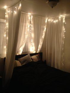 """DIY bed canopy under $50! Joann's 84"""" home sheer fabric, painted wooden dowels, white ceiling hooks, Christmas lights, and a stapler. No sew! Less than an hour."""