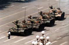 """Tiananmen Square. The iconic image of """"Tank Man"""", taken by Associated Press journalist Jeff Widener on Chang'an Avenue following the suppression of the protests in Beijing and other cities,15 April 1989 – 4 June 1989"""
