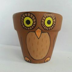 Hey, I found this really awesome Etsy listing at https://www.etsy.com/listing/243624147/owl-hand-painted-clay-pot