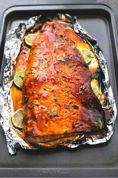 Sweet and spicy, baked honey sriracha lime salmon in foil is tender and flaky and has the most incredible flavors. A healthy and easy 30 minute meal for salmon lovers.   lecremedelacrumb.com