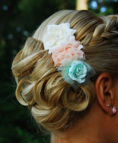 For the bridesmaids, consider adding a hair accessory that will complete their attire!