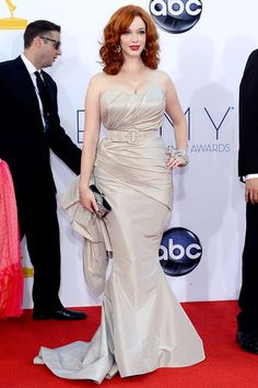 Christina Hendricks showed off her famous curves in a belted Christian Siriano dress.